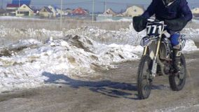 Slow motion: sportsman racer man fulfills a fast ride on a motorcycle on the road extreme. The race track is very curve stock footage