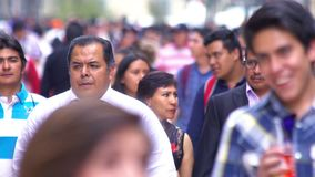 SLOW MOTION-TAKE 5: Crowd walking through street. In Mexico the population growing is a public problem due the high birth rates. Mexico City, CIRCA June,2018 stock video