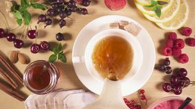 Slow motion tea is poured into a cup. Top view stock video