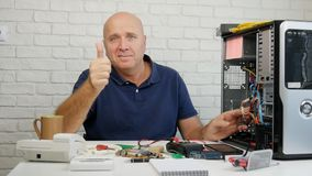 Slow Motion with Technician Fixing Computer Problems Smiling and Thumbs Up Happy.  stock footage