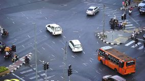 Slow-motion of traffic at Hua Lamphong intersection in Bangkok, Thailand stock footage