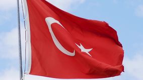 Slow motion of turkish flag waving on blue sky. Closeup. Slow motion of turkish flag waving on blue sky. Close up stock footage