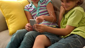 In slow motion two children listenning music. At home stock video
