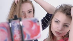 Slow-Motion of Two Girls Making Selfie stock video