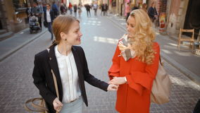 Slow Motion of Two Happy Girlfriends Walking in the Old Town, Talking, Smiling stock video footage