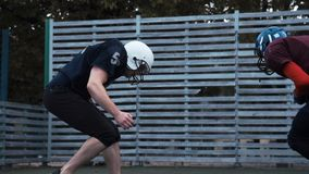 Two helmeted football players stock video footage