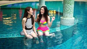 Slow motion of two women friends enjoy in swimming pool. Slow motion of two women friends enjoy in the swimming pool stock video footage