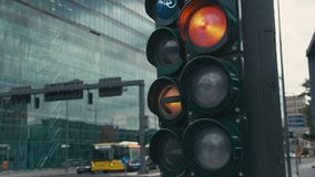 Slow motion a typical traffic light at the crossroads in the center of the capital of Germany, Berlin. Green arrow is on. Switches to yellow and red. In the stock footage