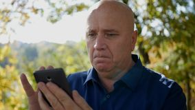 Slow Motion with Upset Man Outdoors Ending a Cellphone Call Conversation.  stock footage