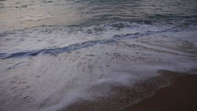 Slow motion vacationer leave hotel to enjoy evening sea. stock footage