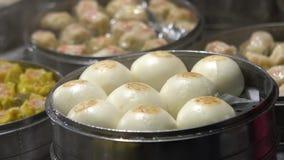 Slow motion Vendor selling Dumpling and Shaomai in Asian Street Food Market. Slow motion vendor preparing and selling Shaomai and customers at Asian Street Food stock video