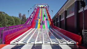 Slow motion video of people enjoying a giant slide stock video