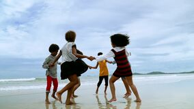 Free Slow Motion Video Shot Of African-American Children Are Dancing And Dancing On The Beach, In The Summer Atmosphere. Stock Image - 186708901