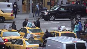 Slow Motion view of pedestrians and cars at NYC intersection (2 of 3) stock video footage