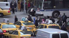 Slow Motion view of pedestrians and cars at NYC intersection (1 of 3) stock footage