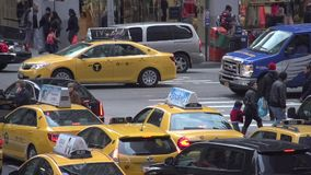 Slow Motion view of pedestrians and cars at NYC intersection (3 of 3) stock video footage