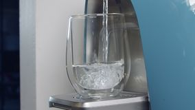 Slow motion of a water cup filling in a water filtering machine stock video