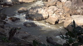 Slow motion of water in mountain river stock footage
