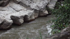 Slow motion of water in mountain river stock video