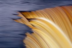 Slow motion waterfall. Details of colorful waterfall with slow motion blur Stock Photo