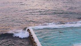 Slow motion wave crashing into Bondi Icebergs stock footage