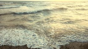 Slow motion waves breaking a shore stock video footage