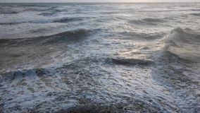 Slow motion waves breaking a shore stock footage