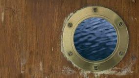Slow Motion Waves Through Porthole stock footage