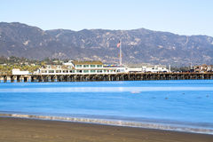 Slow motion waves in Santa Barbara bay. Image of a long exposure in Santa Barbara Harbor California with famous Stearns Wharf lining the blue water Stock Photo
