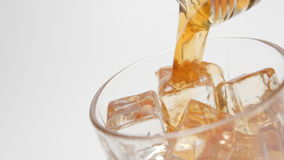 SLOW MOTION: Whiskey pour in a glass with an ice cubes - close up stock footage