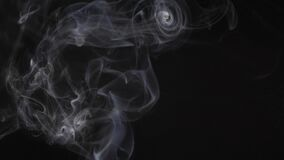 Slow motion of white abstract cigarette smoke