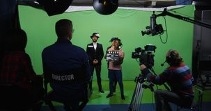Actor and actress performing a scene. Slow motion wide shot of a cameraman recording an actor and an actress performing a romantic scene stock images