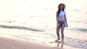 Slow motion of woman enjoy on sea beach. Slow motion of woman enjoy on the sea beach stock footage