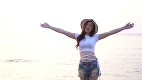 Slow motion of woman enjoy on sea beach. Slow motion of woman enjoy on the sea beach stock video