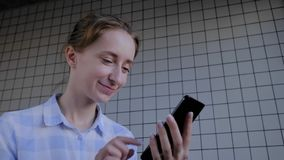 Woman holding smartphone and using voice recognition function: online technology