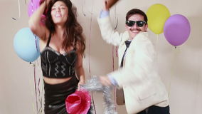 Slow motion of woman and man having awesome time dancing in photo booth stock video footage