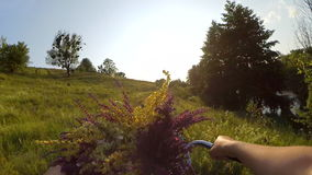 Slow Motion. Woman is riding a bicycle through a field stock footage