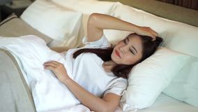 Slow motion of woman sleepless on bed. Slow motion of woman sleepless on a bed stock video