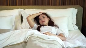 Slow motion of woman sleepless on bed. Slow motion of woman sleepless on a bed stock footage