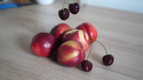 Slow motion woman taking cherries from the table. Slow motion woman taking cherries from the wood table stock video