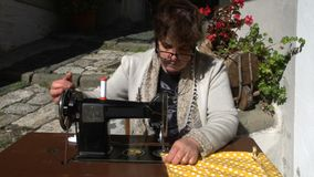 Vintage sewing machine frontal outdoors slow motion MF stock video