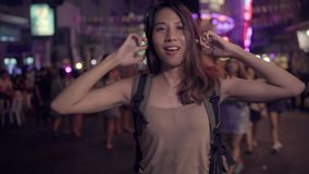 Slow motion - Young Asian traveling women backpacker drinking alcohol or beer and dancing in urban street night party. Slow motion - Young Asian traveling women stock video