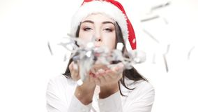 Slow motion young attractive businesswoman blowing silver confetti celebrating for Christmas and New Year. Slow motion young attractive businesswoman blowing stock video footage