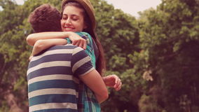 In slow motion young couple hugging in the park stock video footage