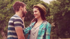 In slow motion young couple smiling at each other stock video footage