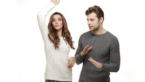 Slow-motion young couple in sweaters enjoy dancing celebrate for christmas fun together feeling attraction. Slow-motion young couple in sweaters enjoy dancing stock footage