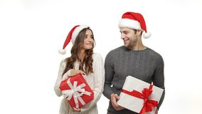 Slow-motion young couple in sweaters enjoy dancing with present celebrate for christmas fun together feeling attraction. Slow-motion young couple in sweaters stock video footage