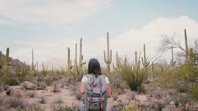 Slow motion young happy excited tourist woman enjoying epic hike at atmospheric cactus desert Arizona national park.