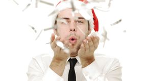 Slow-motion young man blowing confetti to camera for Christmas celebration. Slow-motion young man blowing confetti to camera for Christmas celebration stock video