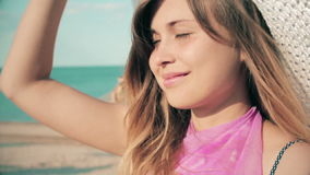Slow motion of young woman looking up at the beach, having a vacation by the sea. Young woman looking up at the beach, having a vacation by the sea stock video footage